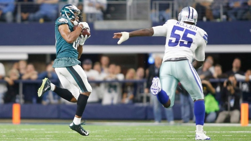 Nov 8, 2015; Arlington, TX, USA; Philadelphia Eagles wide receiver Jordan Matthews (81) catches a pass and runs for a touchdown while defended by Dallas Cowboys middle linebacker Rolando McClain (55) in overtime at AT&T Stadium. Philadelphia won in overtime 33-27. Mandatory Credit: Tim Heitman-USA TODAY Sports
