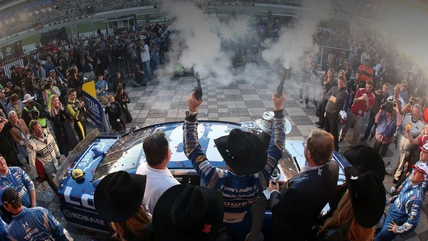 <p>FORT WORTH, TX - NOVEMBER 08: Jimmie Johnson, driver of the #48 Lowe's Chevrolet, celebrates in victory lane after winning the NASCAR Sprint Cup Series AAA Texas 500 at Texas Motor Speedway on November 8, 2015 in Fort Worth, Texas. (Photo by Tim Bradbury/Getty Images for Texas Motor Speedway)</p>