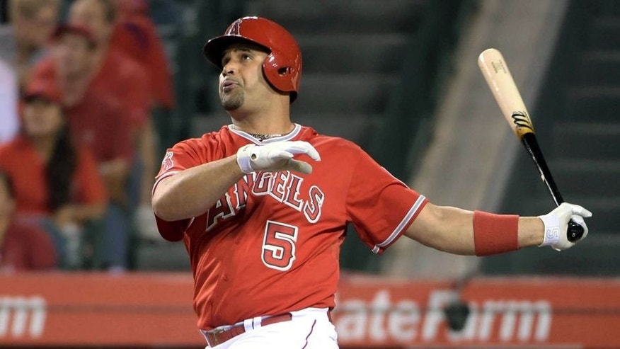Sep 25, 2015; Anaheim, CA, USA; Los Angeles Angels first baseman Albert Pujols (5) follows through on a two-run home run in the first inning at Angel Stadium of Anaheim. Mandatory Credit: Kirby Lee-USA TODAY Sports