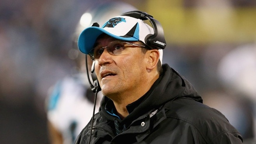 CHARLOTTE, NC - JANUARY 03: Carolina Panthers head coach Ron Rivera checks a replay on the big screen in the 1st half against the Arizona Cardinals  during their NFC Wild Card Playoff game at Bank of America Stadium on January 3, 2015 in Charlotte, North Carolina.  (Photo by Streeter Lecka/Getty Images)