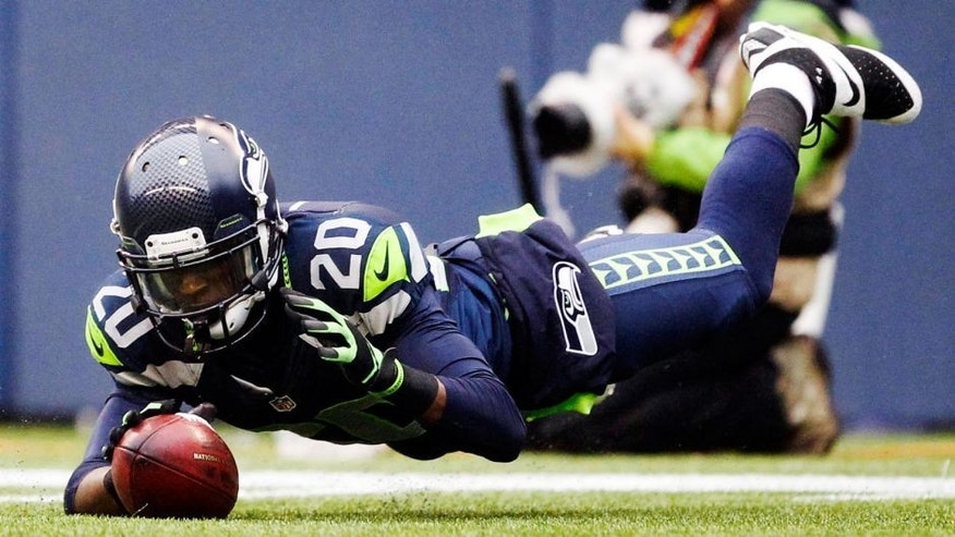 Dec 22, 2013; Seattle, WA, USA; Seattle Seahawks cornerback Jeremy Lane (20) downs a punt inside the five-yard line against the Arizona Cardinals during the second quarter at CenturyLink Field. Mandatory Credit: Joe Nicholson-USA TODAY Sports