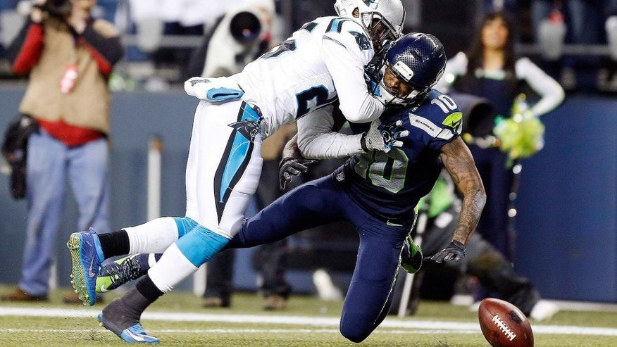 <p>January 10, 2015; Seattle, WA, USA; Carolina Panthers cornerback Bene' Benwikere (25) breaks up a pass intended for Seattle Seahawks wide receiver Paul Richardson (10) during the second half in the 2014 NFC Divisional playoff football game at CenturyLink Field. Mandatory Credit: Joe Nicholson-USA TODAY Sports</p>