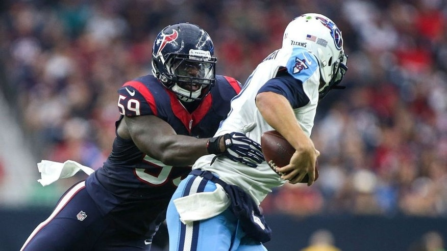 Nov 1, 2015; Houston, TX, USA; Houston Texans outside linebacker Whitney Mercilus (59) attempts to sack Tennessee Titans quarterback Zach Mettenberger (7) during the second quarter at NRG Stadium. Mandatory Credit: Troy Taormina-USA TODAY Sports