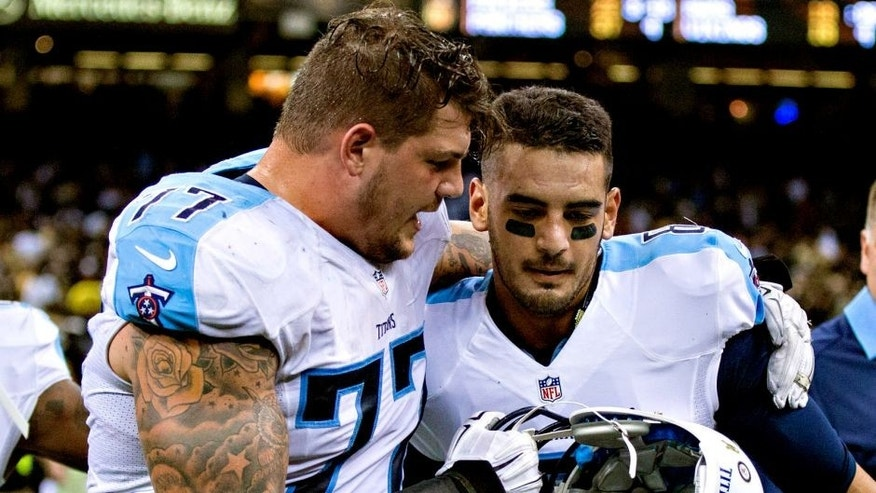 NEW ORLEANS, LA - NOVEMBER 8: Marcus Mariota #8 is congratulated by Taylor Lewan #77 of the Tennessee Titans after a game against the New Orleans Saints at Mercedes-Benz Superdome on November 8, 2015 in New Orleans, Louisiana. The Titans defeated the Saints in overtime 34-28. (Photo by Wesley Hitt/Getty Images)