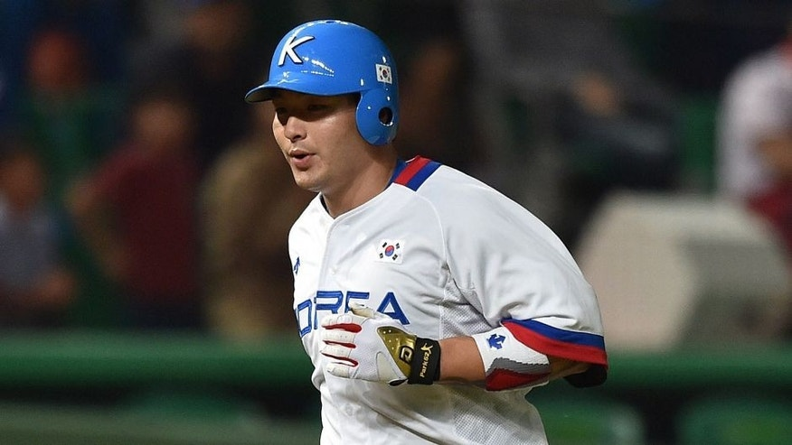 Baseball player Park Byung-Ho of South Korea (R) rounds the bases after hitting a homerun during the men's semifinal game 14 against China at Munhak Baseball Stadium during the 17th Asian Games in Incheon on September 27, 2014. AFP PHOTO / Bay ISMOYO (Photo credit should read BAY ISMOYO/AFP/Getty Images)
