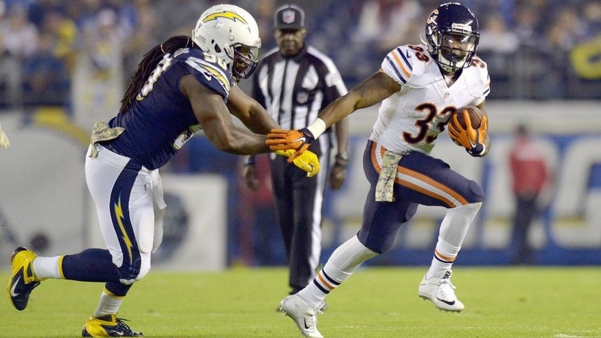 Nov 9, 2015; San Diego, CA, USA; Chicago Bears running back Jeremy Langford (33) is defended by San Diego Chargers defensive end Ricardo Mathews (90) during the first quarter at Qualcomm Stadium. Mandatory Credit: Jake Roth-USA TODAY Sports