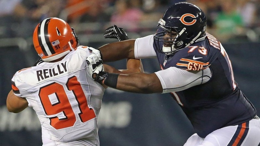 CHICAGO, IL - SEPTEMBER 03: Tayo Fabuluje #73 of the Chicago Bears blocks Mike Reilly #91 of the Cleveland Browns during a preseason game at Soldier Field on September 3, 2015 in Chicago, Illinois. The Bears defeated the Browns 24-0. (Photo by Jonathan Daniel/Getty Images)