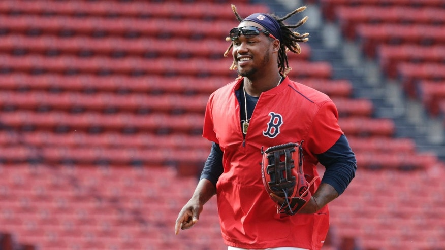 FILE -  In this July 7, 2015 photograph, Boston Red Sox outfielder Hanley Ramirez runs across the infield at Fenway Park in Boston.  New Boston Red Sox boss Dave Dombrowski says the team is committed to playing Hanley Ramirez at first base next season. Dombrowski says Ramirez and his representatives are also on board with the plan.  (AP Photo/Charles Krupa, File)