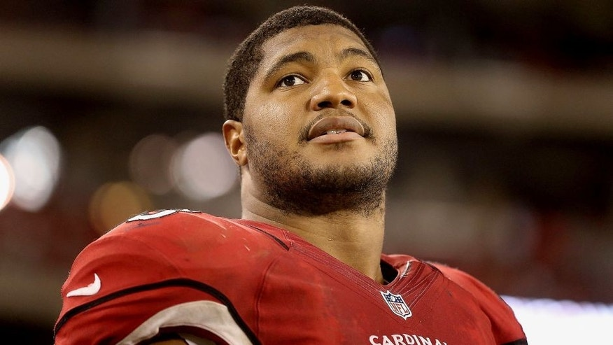 GLENDALE, AZ - AUGUST 24: Defensive end Calais Campbell #93 of the Arizona Cardinals watches from sidelines during the preseason NFL game against the San Diego Chargers at the University of Phoenix Stadium on August 24, 2013 in Glendale, Arizona. (Photo by Christian Petersen/Getty Images) *** Local Caption *** Calais Campbell