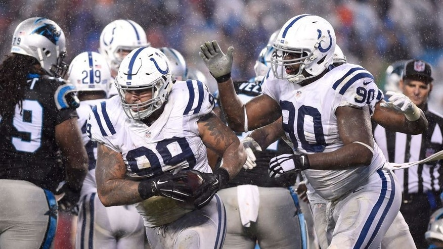 Nov 2, 2015; Charlotte, NC, USA; Indianapolis Colts defensive tackle Billy Winn (99) recovers a fumble and celebrates with defensive end Kendall Langford (90) in the third quarter at Bank of America Stadium. Mandatory Credit: Bob Donnan-USA TODAY Sports