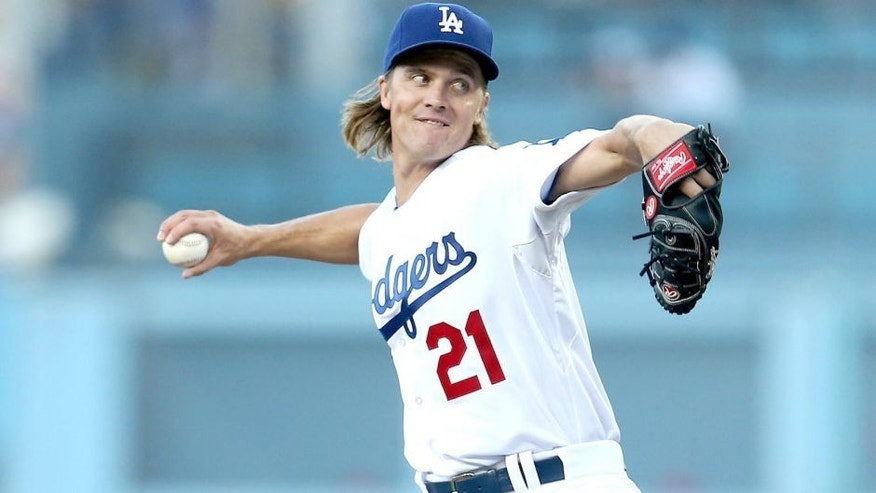 LOS ANGELES, CA - JULY 31: Zack Greinke #21 of the Los Angeles Dodgers throws a pitch against the Los Angeles Angels of Anaheim at Dodger Stadium on July 31, 2015 in Los Angeles, California. (Photo by Stephen Dunn/Getty Images)