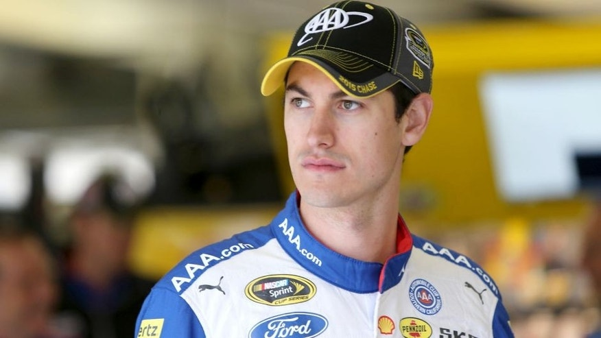 FORT WORTH, TX - NOVEMBER 07: Joey Logano, driver of the #22 AAA Insurance Ford, stands in the garage area during practice for the NASCAR Sprint Cup Series AAA Texas 500 at Texas Motor Speedway on November 7, 2015 in Fort Worth, Texas. (Photo by Jerry Markland/Getty Images for Texas Motor Speedway)