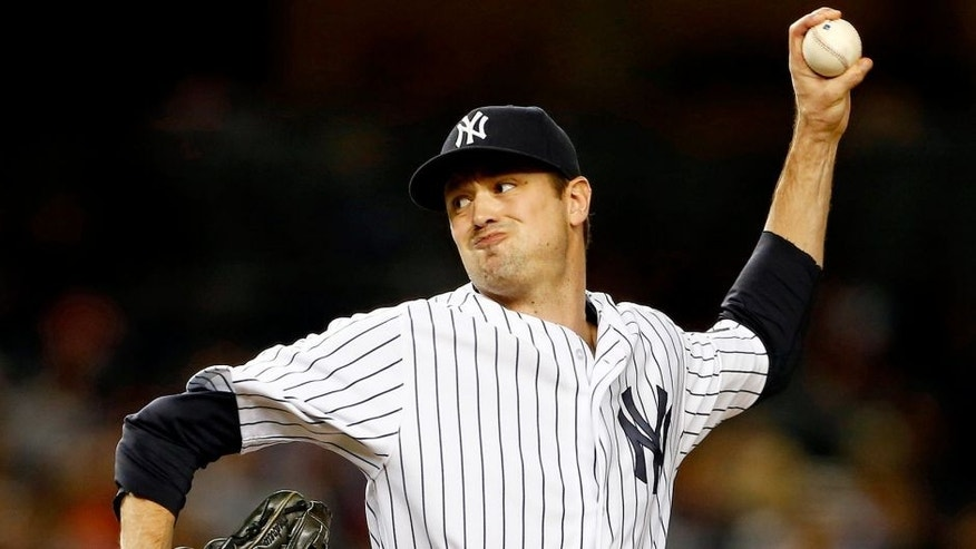 NEW YORK, NY - SEPTEMBER 24: Pitcher Andrew Miller #48 of the New York Yankees delivers a pitch against the Chicago White Sox during the ninth inning of a MLB baseball game at Yankee Stadium on September 24, 2015 in the Bronx borough of New York City. The Yankees defeated the White Sox 3-2. (Photo by Rich Schultz/Getty Images)