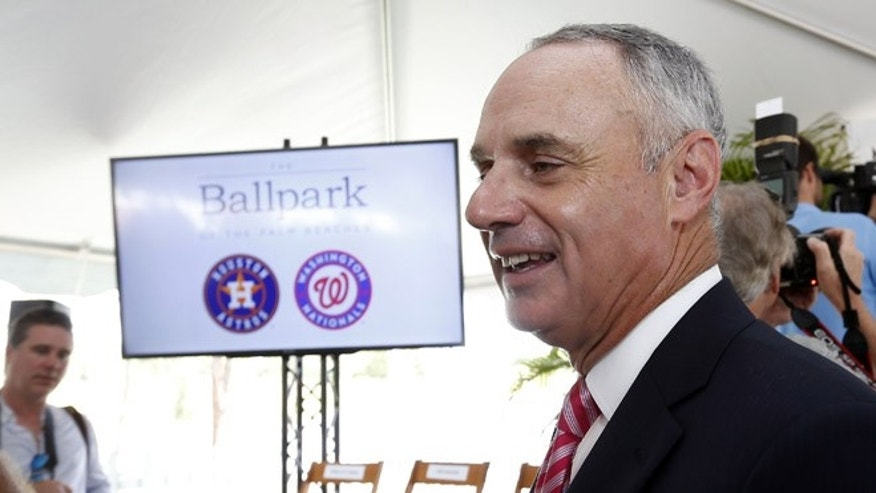 Major League Baseball commissioner Rob Manfred speaks with reporters after the groundbreaking ceremony for the future home of the of Houston Astros and the Washington Nationals spring training facility on Monday, Nov. 9, 2015, in West Palm Beach, Fla. (AP Photo/Steve Mitchell)