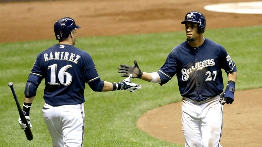 MILWAUKEE, WI - SEPTEMBER 12: Carlos Gomez #27 of the Milwaukee Brewers celebrates with Aramis Ramirez #16 after getting driven home on a single hit by Jonathan Lucroy in the bottom of the fourth inning against the Cincinnati Reds against the Milwaukee Brewers during the game at Miller Park on September 12, 2014 in Milwaukee, Wisconsin. (Photo by Mike McGinnis/Getty Images)