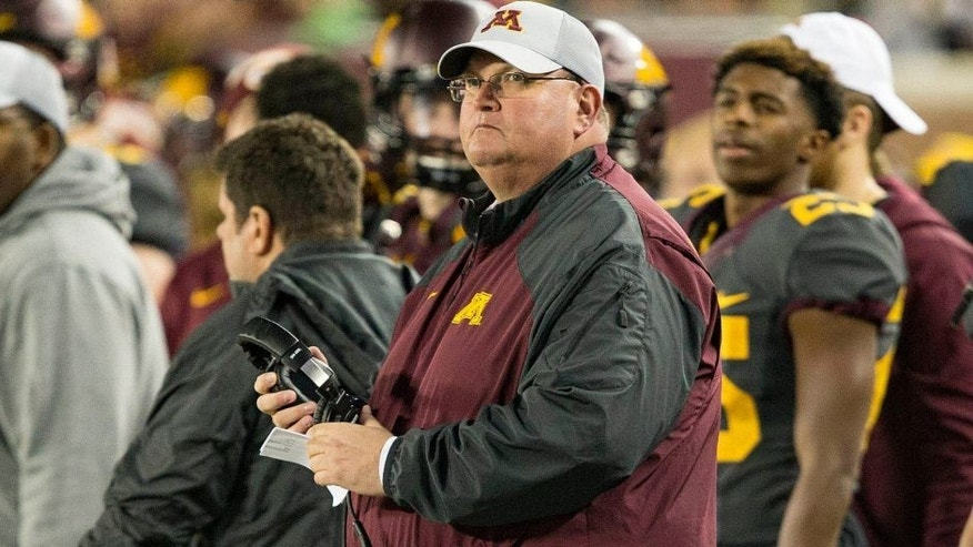 <p>Oct 31, 2015; Minneapolis, MN, USA; Minnesota Golden Gophers interim head coach Tracy Claeys looks on during the first quarter against the Michigan Wolverines at TCF Bank Stadium. Mandatory Credit: Jesse Johnson-USA TODAY Sports</p>