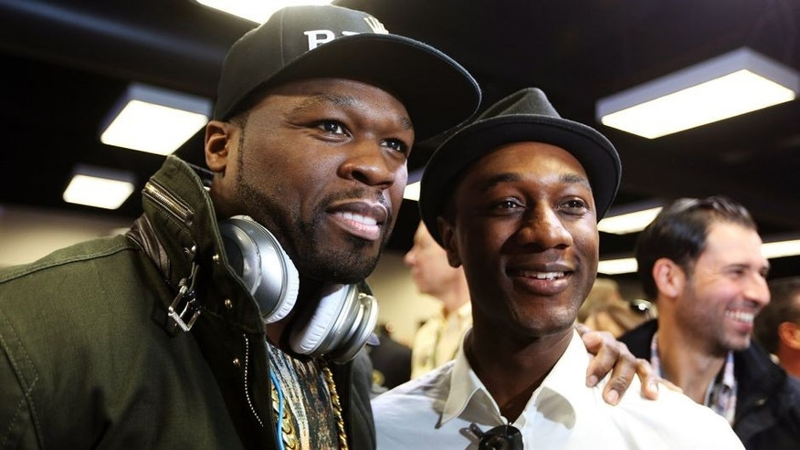 "DAYTONA BEACH, FL - FEBRUARY 23: Curtis ""50 Cent"" Jackson poses with singer Aloe Blacc before the NASCAR Sprint Cup Series Daytona 500 at Daytona International Speedway on February 23, 2014 in Daytona Beach, Florida. (Photo by Jerry Markland/Getty Images)"