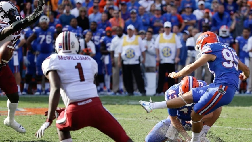 South Carolina safety Brison Williams, far left, blocks a field goal attempt by Florida place kicker Francisco Velez (95) during the second half of an NCAA college football game in Gainesville, Fla., Saturday, Nov. 15, 2014. South Carolina won in overtime 23-20. (AP Photo/John Raoux)