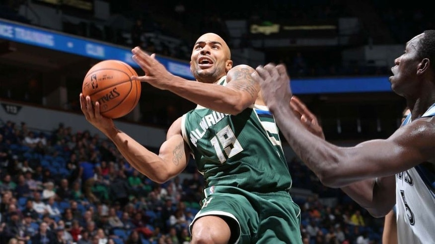 The Milwaukee Bucks' Jerryd Bayless shoots the ball against the Minnesota Timberwolves during a preseason game on Oct. 23, 2015, at Target Center in Minneapolis.