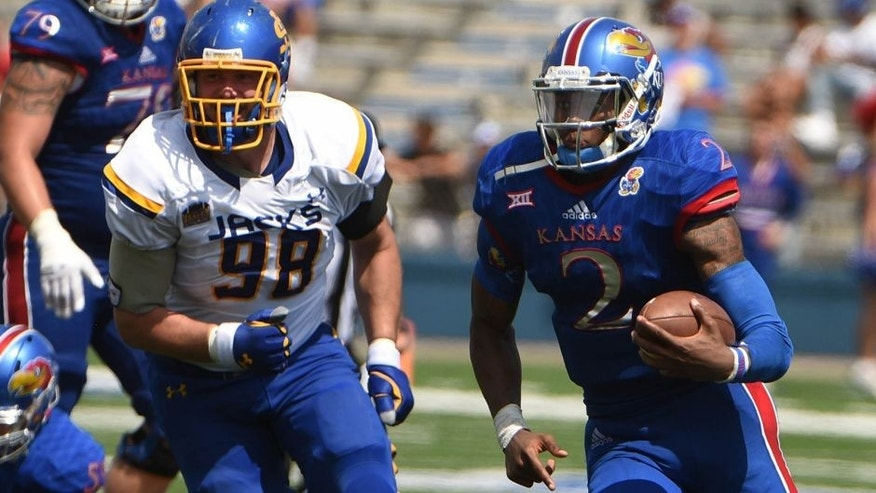 Sep 5, 2015; Lawrence, KS, USA; Kansas Jayhawks quarterback Montell Cozart (2) runs for yardage against the South Dakota State Jackrabbits in the second half at Memorial Stadium. South Dakota State won the game 41-38. Mandatory Credit: John Rieger-USA TODAY Sports