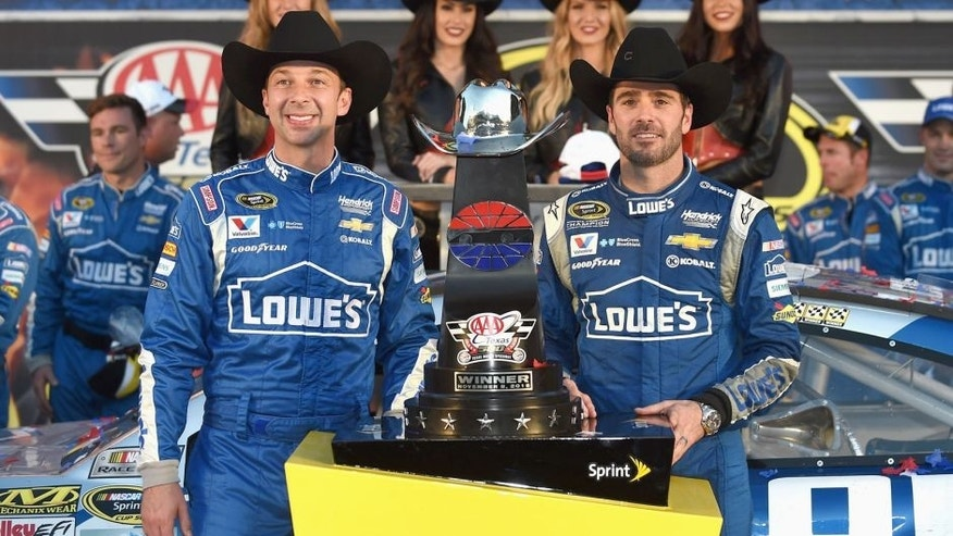 FORT WORTH, TX - NOVEMBER 08: Jimmie Johnson, driver of the #48 Lowe's Chevrolet, and crew chief Chad Knaus celebrate in victory lane with the trophy after winning the NASCAR Sprint Cup Series AAA Texas 500 at Texas Motor Speedway on November 8, 2015 in Fort Worth, Texas. (Photo by Rainier Ehrhardt/NASCAR via Getty Images)