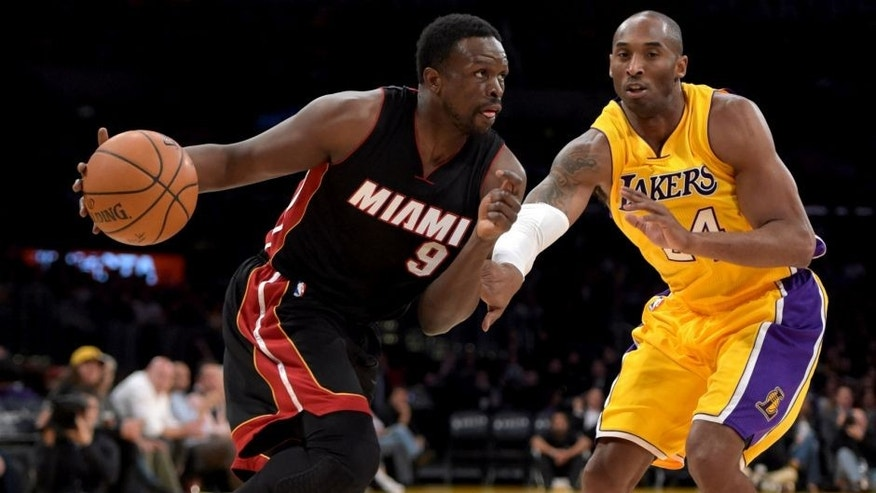 <p>Jan 13, 2015; Los Angeles, CA, USA; Miami Heat forward Luol Deng (9) is defended by Los Angeles Lakers guard Kobe Bryant (24) at Staples Center. The Heat defeated the Lakers 78-75. Mandatory Credit: Kirby Lee-USA TODAY Sports</p>