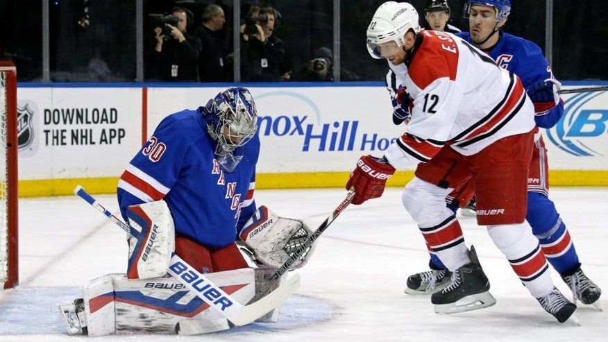 Nov 10, 2015; New York, NY, USA; New York Rangers goalie Henrik Lundqvist (30) makes a save on a shot by Carolina Hurricanes center Eric Staal (12) during the first period of an NHL hockey game at Madison Square Garden. Mandatory Credit: Adam Hunger-USA TODAY Sports