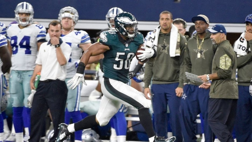 Philadelphia Eagles' Jordan Hicks (58) runs back an interception from the Dallas Cowboys for a touchdown in the second half of an NFL football game, Sunday, Nov. 8, 2015, in Arlington, Texas. (AP Photo/Michael Ainsworth)