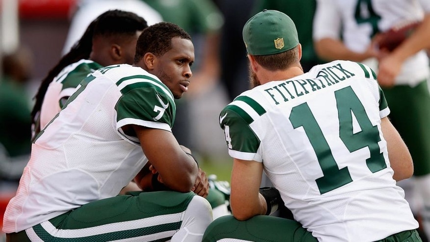 OAKLAND, CA - NOVEMBER 01: Geno Smith #7 of the New York Jets talks to Ryan Fitzpatrick #14 on the sidelines during their game against the Oakland Raiders at O.co Coliseum on November 1, 2015 in Oakland, California. (Photo by Ezra Shaw/Getty Images)
