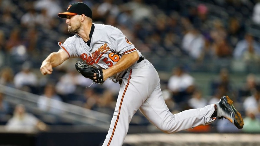 NEW YORK, NY - SEPTEMBER 09: Darren O'Day #56 of the Baltimore Orioles in action against the New York Yankees at Yankee Stadium on September 9, 2015 in the Bronx borough of New York City. (Photo by Rich Schultz/Getty Images)