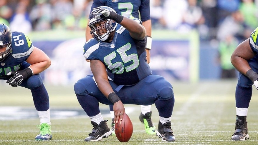 Nov 23, 2014; Seattle, WA, USA; Seattle Seahawks center Patrick Lewis (65) signals for blocking assignments before a snap against the Arizona Cardinals during the second quarter at CenturyLink Field. Mandatory Credit: Joe Nicholson-USA TODAY Sports