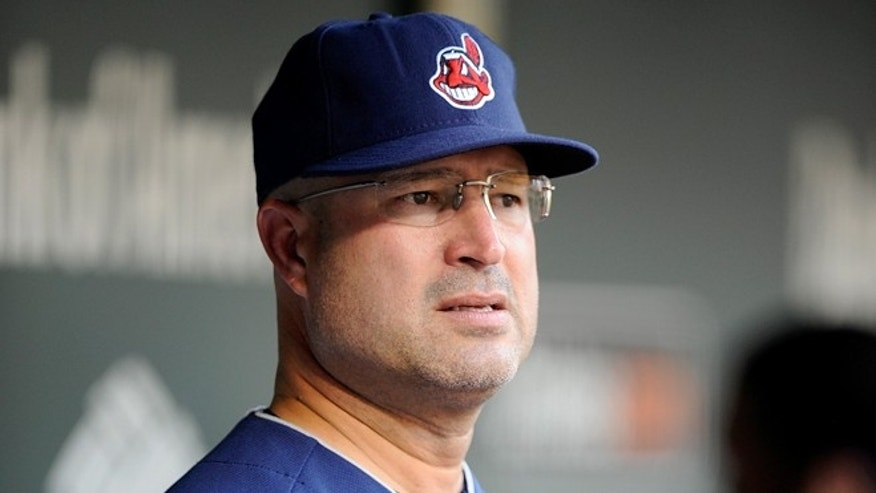 Manny Acta, as manager of the Cleveland Indians, watches the game against the Baltimore Orioles at Oriole Park at Camden Yards on June 28, 2012 in Baltimore, Maryland.  (Photo by Greg Fiume/Getty Images)