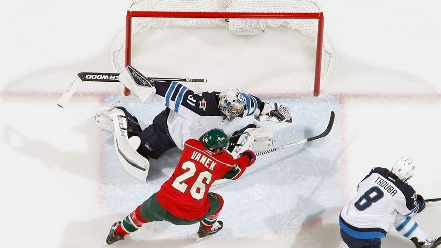 ST. PAUL, MN - NOVEMBER 10: Ondrej Pavelec #31 of the Winnipeg Jets makes a save against Thomas Vanek #26 of the Minnesota Wild during the game on November 10, 2015 at the Xcel Energy Center in St. Paul, Minnesota. (Photo by Bruce Kluckhohn/NHLI via Getty Images)