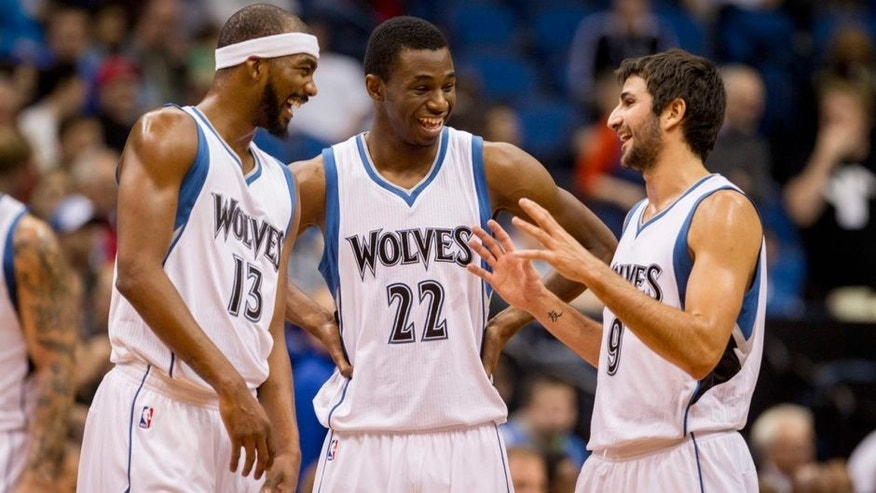 <p>Oct 10, 2014; Minneapolis, MN, USA; Minnesota Timberwolves forward Corey Brewer (13) and guard Andrew Wiggins (22) and guard Ricky Rubio (9) talk during a break in the game against the Philadelphia 76ers at Target Center. The Timberwolves win 116-110. Mandatory Credit: Bruce Kluckhohn-USA TODAY Sports</p>