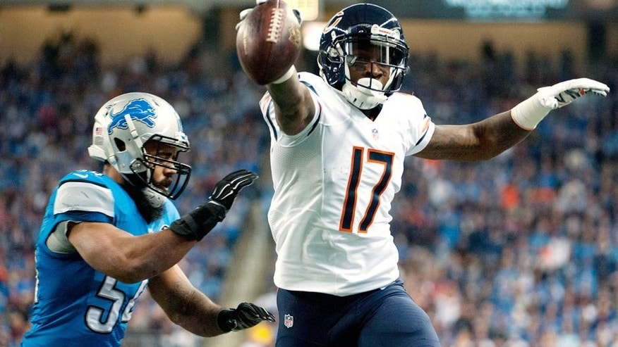Nov 27, 2014; Detroit, MI, USA; Chicago Bears wide receiver Alshon Jeffery (17) runs past Detroit Lions outside linebacker DeAndre Levy (54) to score a touchdown during the first quarter at Ford Field. Mandatory Credit: Tim Fuller-USA TODAY Sports