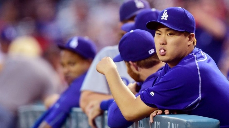 ANAHEIM, CA - SEPTEMBER 09: Hyun-Jin Ryu #99 of the Los Angeles Dodgers waits for play to begin against the Los Angeles Angels of Anaheim at Angel Stadium of Anaheim on September 9, 2015 in Anaheim, California. (Photo by Harry How/Getty Images)