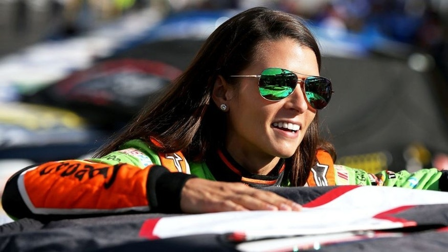 BRISTOL, TN - AUGUST 21: Danica Patrick, driver of the #10 GoDaddy Chevrolet, stands on the grid during qualifying for the NASCAR Sprint Cup Series Irwin Tools Night Race at Bristol Motor Speedway on August 21, 2015 in Bristol, Tennessee. (Photo by Sean Gardner/Getty Images)