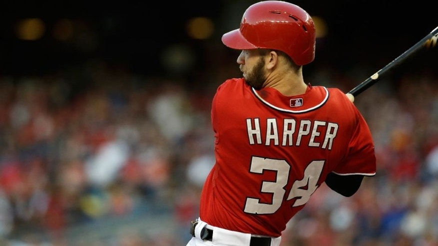 <p>Washington Nationals, Bryce Harper (34) lines out to center during the first inning of a baseball game against the Milwaukee Brewers at Nationals Park in Washington, Saturday, Aug. 22, 2015. (AP Photo/Jacquelyn Martin)</p>