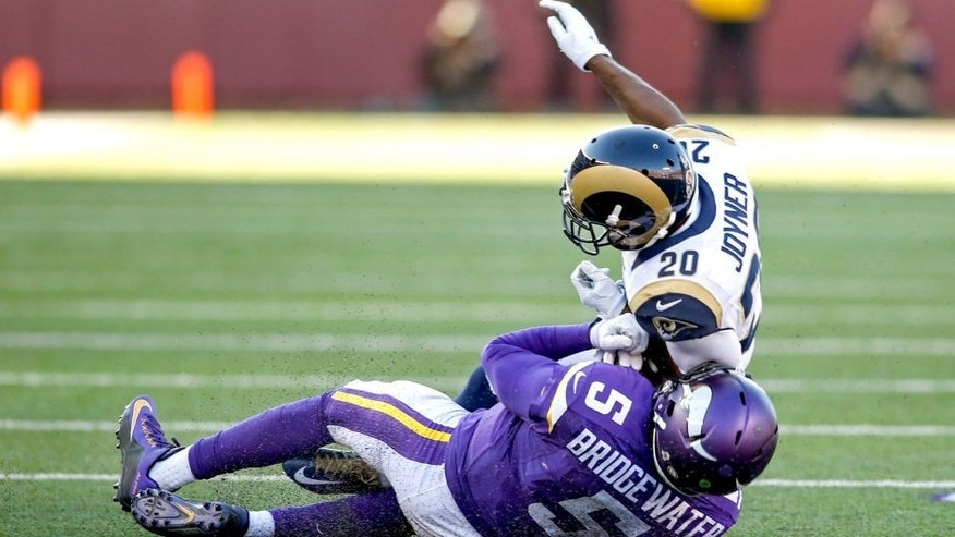 Nov 8, 2015; Minneapolis, MN, USA; St. Louis Rams cornerback Lamarcus Joyner (20) collides with Minnesota Vikings quarterback Teddy Bridgewater (5) for a personal foul in the fourth quarter at TCF Bank Stadium. Bridgewater did not return. The Vikings win 21-18. Mandatory Credit: Bruce Kluckhohn-USA TODAY Sports