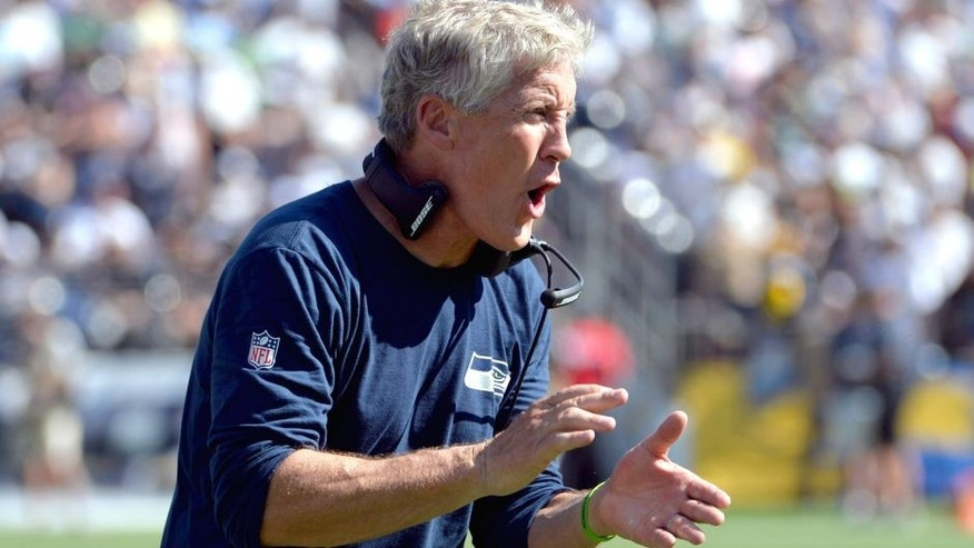Sep 14, 2014; San Diego, CA, USA; Seattle Seahawks head coach Pete Carroll reacts to a third quarter touchdown against the San Diego Chargers at Qualcomm Stadium. Mandatory Credit: Robert Hanashiro-USA TODAY Sports