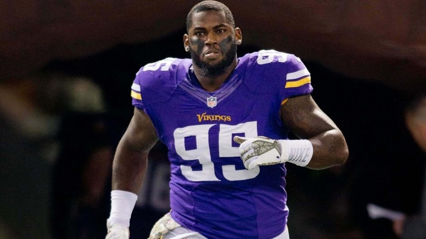 <p>Nov 7, 2013; Minneapolis, MN, USA; Minnesota Vikings defensive tackle Sharrif Floyd (95) runs onto the field during introductions before the game with the Washington Redskins at Mall of America Field at H.H.H. Metrodome. The Vikings win 34-27.  </p>