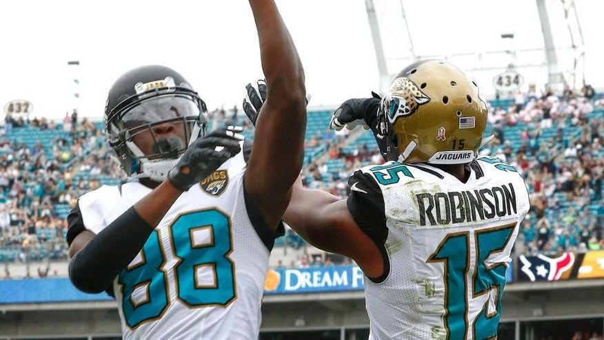 Oct 18, 2015; Jacksonville, FL, USA; Jacksonville Jaguars wide receiver Allen Robinson (15) and wide receiver Allen Hurns (88) celebrate a touchdown during the second half of a football game against the Houston Texans at EverBank Field. Mandatory Credit: Reinhold Matay-USA TODAY Sports
