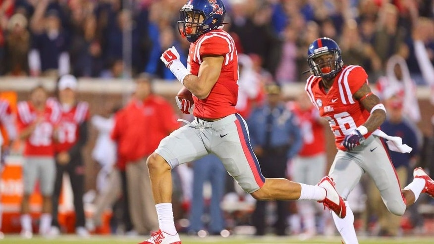 Nov 29, 2014; Oxford, MS, USA; Mississippi Rebels tight end Evan Engram (17) carries the ball against the Mississippi State Bulldogs at Vaught-Hemingway Stadium. The Rebels won 31-17. Mandatory Credit: Spruce Derden-USA TODAY Sports