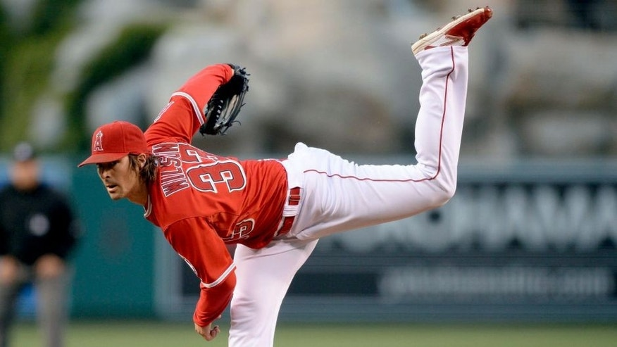 May 12, 2015; Anaheim, CA, USA; Los Angeles Angels starting pitcher C.J. Wilson (33) pitches against the Colorado Rockies during the second inning at Angel Stadium of Anaheim. Mandatory Credit: Kelvin Kuo-USA TODAY Sports