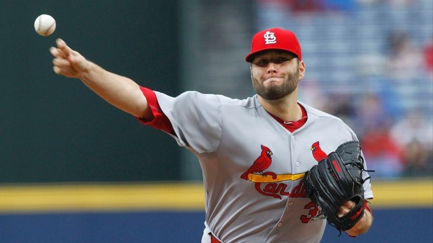 Oct 4, 2015; Atlanta, GA, USA; St. Louis Cardinals starting pitcher Lance Lynn (31) throws a pitch against the Atlanta Braves in the first inning at Turner Field. Mandatory Credit: Brett Davis-USA TODAY Sports