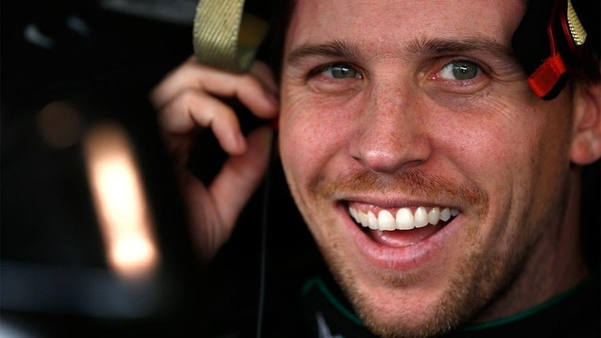 MARTINSVILLE, VA - OCTOBER 31: Denny Hamlin, driver of the #11 FedEx Ground Toyota, sits in his car during practice for the NASCAR Sprint Cup Series Goody's Headache Relief Shot 500 at Martinsville Speedway on October 31, 2015 in Martinsville, Virginia. (Photo by Jeff Zelevansky/Getty Images)