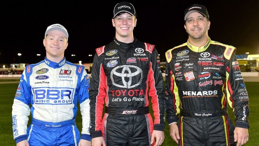 FORT WORTH, TX - NOVEMBER 06: (L-R) NASCAR Camping World Truck Series championship contenders Tyler Reddick, driver of the #19 Stoney Creek Records Ford, Erik Jones, driver of the #4 Toyota, and Matt Crafton, driver of the #88 Damp Rid/Menards Toyota, pose for a photograph prior to the NASCAR Camping World Truck Series WinStar World Casino 350 at Texas Motor Speedway on November 6, 2015 in Fort Worth, Texas. (Photo by Jared C. Tilton/NASCAR via Getty Images)
