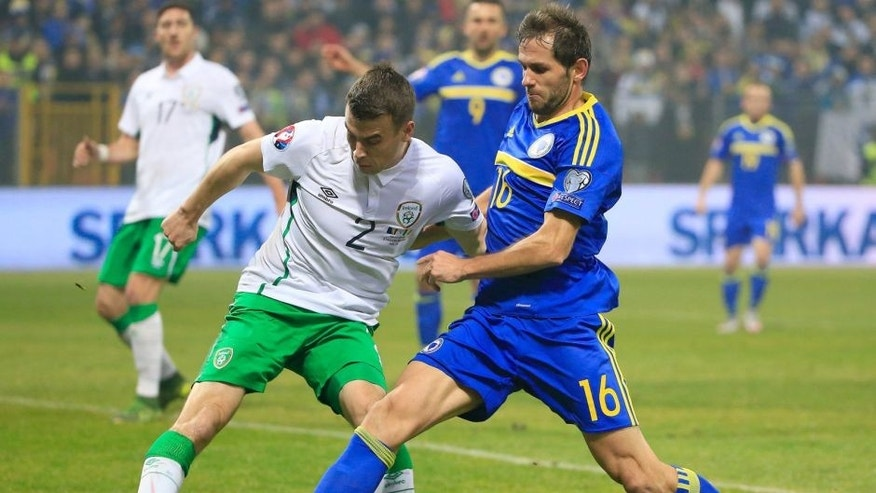 ZENICA, BOSNIA AND HERZEGOVINA - NOVEMBER 13. Seamus Coleman (L) of Ireland in action against Senad Lulic (R) of Bosnia during the EURO 2016 Qualifier Play-Off First Leg between Bosnia and Herzegovina and Republic of Ireland at Bilino Polje Stadium on November 13, 2015 in Zenica, Bosnia and Herzegovina. (Photo by Srdjan Stevanovic/Getty Images)
