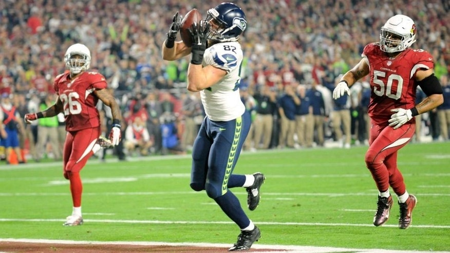 Dec 21, 2014; Glendale, AZ, USA; Seattle Seahawks tight end Luke Willson (82) catches a touchdown pass against the Arizona Cardinals during the second half at University of Phoenix Stadium. Mandatory Credit: Joe Camporeale-USA TODAY Sports