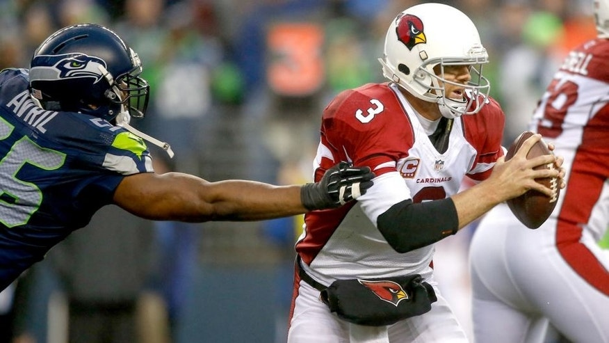 SEATTLE, WA - DECEMBER 22: Quarterback Carson Palmer #3 of the Arizona Cardinals rushes against the Seattle Seahawks at CenturyLink Field on December 22, 2013 in Seattle, Washington. (Photo by Otto Greule Jr/Getty Images)